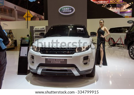 NONTHABURI, THAILAND - MARCH 30: Unidentified female model with Land Rover Range Rover Evoque at the 36th Bangkok International Motor Show 2015 on March 30, 2015 in Nonthaburi, Thailand. - stock photo