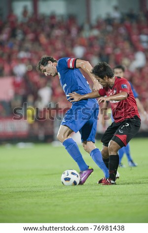 NONTHABURI THAILAND- MAY 10 : A.Duric (blue) in action during the AFC CUP Group G between Muang Thong UTD vs Tampines Rovers Fc on May 10, 2011 at Yamaha Stadium in Nonthaburi, Thailand