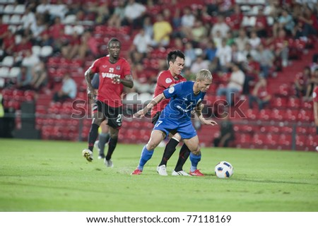 NONTHABURI THAILAND - MAY 10 : A.Khamarudin (blue) in action during the AFC CUP Group G between Muang Thong UTD vs Tampines Rovers Fc on May 10, 2011 at Yamaha Stadium in Nonthaburi, Thailand