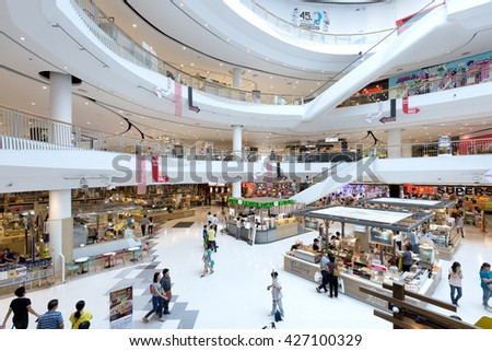 Nonthaburi, Thailand - May 26, 2016: Crowd of people are shopping in the Central Westgate shopping mall in Nonthaburi, Thailand. It is a shopping complex and was founded in 1982. - stock photo