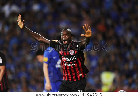 NONTHABURI THAILAND-MAY 27:Dagno Siaka of SCG MuangThong utd. run celebrates after scoring during Thai Premier League between SCG Muangthong Utd.and Chonburi F.C. on May27,2012 in Nonthaburi,Thailand