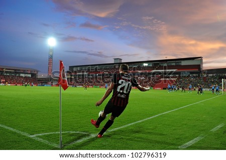 NONTHABURI THAILAND-MAY 17:Mario Gjurovski (no.20) of SCG Muangthong Utd.in action during Thai Premier League between SCG Muangthong Utd.and Army United FC.on May17,2012 in Nonthaburi,Thailand - stock photo