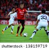 NONTHABURI THAILAND-May11:Mario Gjurovski of SCG Muangthong Utd.in action during Thai Premier League 2013 between SCG Muangthong Utd.and Insee Police UTD.at SCG Stadium on May11,2013 in,Thailand   - stock photo