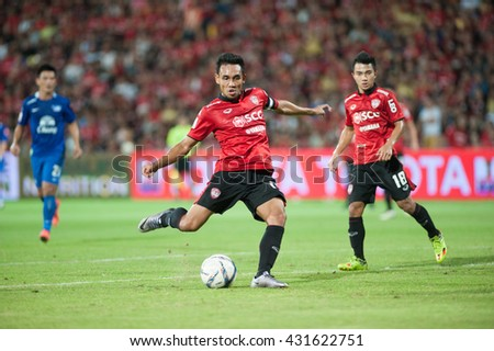 NONTHABURI,THAILAND-MAY 1 : teerasil dangda player of SCG Muangthong United in action during the game between SCG Muangthong United (R) and Chonburi FC (B) at SCG Stadium on May 1, 2016 in,Thailand. - stock photo