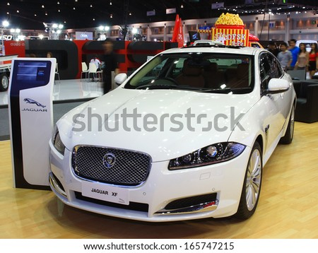 NONTHABURI, THAILAND - NOVEMBER 28 : Jaguar XF car on display at The 30th Thailand International Motor Expo on November 28, 2013 in Nonthaburi, Thailand. - stock photo