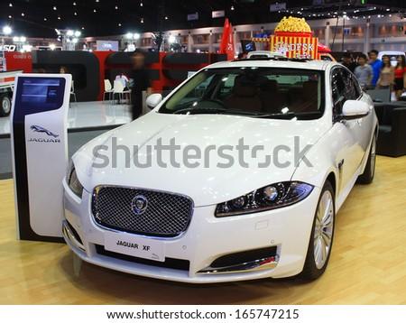 NONTHABURI, THAILAND - NOVEMBER 28 : Jaguar XF car on display at The 30th Thailand International Motor Expo on November 28, 2013 in Nonthaburi, Thailand. - stock photo