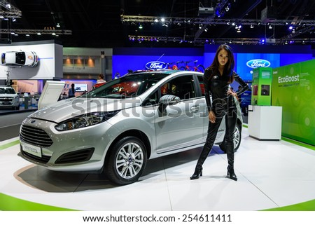 NONTHABURI, THAILAND - NOVEMBER 28: Unidentified female model with Ford New Fiesta at the 31st Thailand International Motor Expo 2014 on November 28, 2014 in Nonthaburi, Thailand.