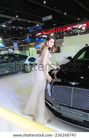 Nonthaburi, Thailand - November 28, 2014: Unidentified model  with BENTLEY pose in the 31th  Thailand International Motor Expo on November 28, 2014 in Nonthaburi, Thailand.
