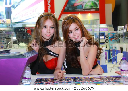 Nonthaburi, Thailand - November 28, 2014: Unidentified model  with Pioneer pose in the 31th  Thailand International Motor Expo on November 28, 2014 in Nonthaburi, Thailand.