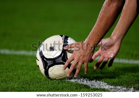NONTHABURI THAILAND-OCT20:Football player man holding ball in during. Thai Premier League between SCG Muangthong Utd.and Bangkok Glass FC.at SCG Stadium on OCTOBER20,2013 in,Thailand  - stock photo