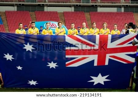NONTHABURI THAILAND-SEPTEMBER 17:Australia players sing the national anthem during the AFC U-16 Championship between Australia and DPR Korea at  Rajamangala Stadium on Sep17,2014,Thailand - stock photo