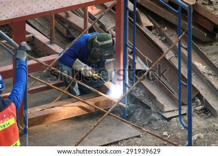 NONTHABURI-THAILAND-SEPTEMBER 20 : Bridge construction under performing the steel reinforcement of welding work of new railway project on September 20, 2014 Nonthaburi Province, Thailand.