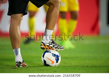 NONTHABURI THAILAND-SEPTEMBER 06:Foot ball being kicked on lawn  during the AFC U-16 Championship between Thailand and Malaysia at Muangthong Stadium on Sep 06, 2014,Thailand - stock photo