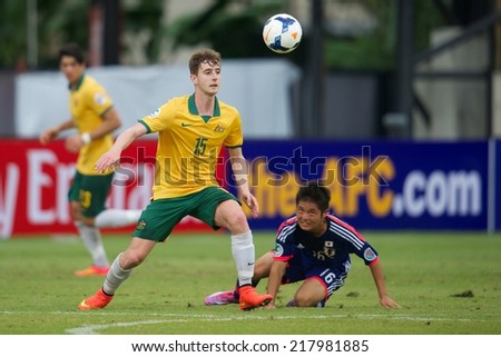 NONTHABURI THAILAND-SEPTEMBER 10:Jackson Bandiera #15  (L) of Australia in action during the AFC U-16 Championship between Australia and Japan at Muangthong Stadium on Sep10 ,2014,Thailand