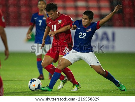 NONTHABURI THAILAND-SEPTEMBER 06:Muhamad Shyamierul Razmee Bin Jams (R)of Malaysia in action during the AFC U-16 Championship between Thailand and Malaysia at Muangthong Stadium on Sep06,2014,Thailand