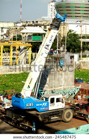 NONTHABURI-THAILAND -SEPTEMBER 20 : The loader & truck for construction concrete bridge over the river at worksite on September 20, 2014, in Nonthaburi, Thailand