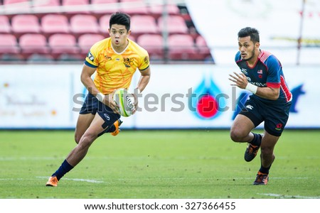 NONTHABURI THAILAND-SEPTEMBER 26:Unidentified rugby players in action during  The Singha Thailand Sevens 2015 between Thailand (yellow) and Malaysia (blue) at SCG Stadium on Sep 26, 2015,Thailand