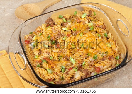 Noodle and cheese casserole in a glass baking dish