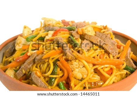 Noodle Beef Stir Fry served in earthenware bowl over white background - stock photo