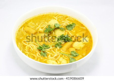 Noodle curry laksa in bowl on white background - stock photo