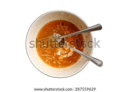 Noodle dirty dish with matal fork and spoon isolated on white background. - stock photo
