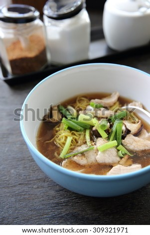 noodle with pork on wood background