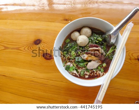Noodle with vegetable, thai style noodle on the table background.