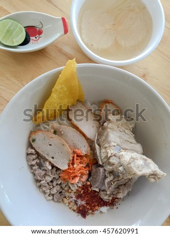 Noodles, pork ribs, pork , peanuts, dried shrimp powder with 1 cup of broth and lemon select focus   - stock photo