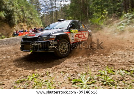 NOOJEE - NOVEMBER 11, 2011: Justin Dowel and Matt Lee on their way to a 2nd outright at Rally Victoria. Winning the overall Australian Rally Championships, November 11, 2011, Noojee, Vic, Australia. - stock photo