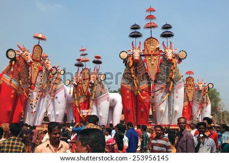 NOORANAD, INDIA - FEB 18: Devotees look at the massive bullock effigies displayed during the Shivratrhri festival at Padanilam Parabrahma temple on February 18,2015 in Nooranad,Kerala, India - stock photo