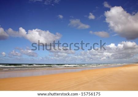 Noosa North Shore beach and clouds, Sunshine Coast, Queensland, Australia - stock photo