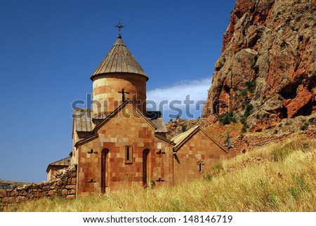 Noravank monastery was founded in 1205. It is located 122 km from Yerevan in a narrow gorge made by the Darichay river, nearby the city of Yeghegnadzor. - stock photo