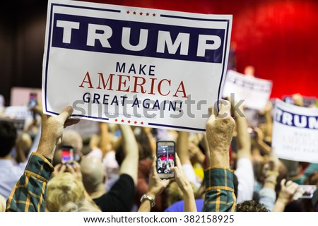 NORCROSS, GA, USA - OCTOBER 10TH, 2015: Supporter holding a campaign sign for a Presidential Candidate from Republican Party Donald Trump at a rally near Atlanta, GA in Norcross - stock photo