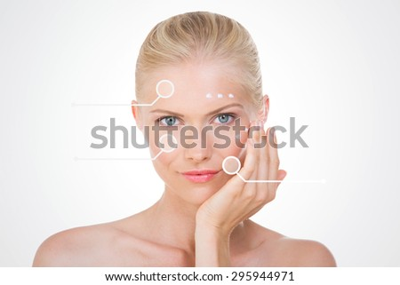 nordic beauty applying cream on her face