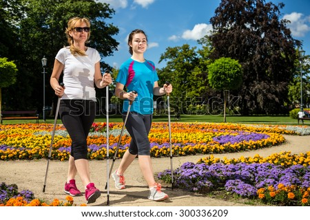 Nordic walking - active people working out in park