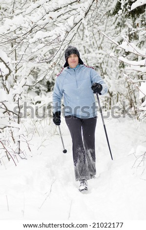Nordic walking at winter time - stock photo