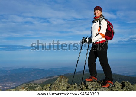 Nordic Walking in Autumn mountains, hiking concept - stock photo