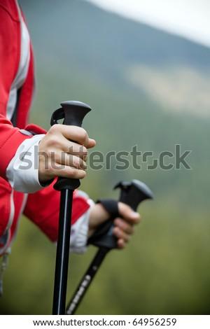 Nordic Walking in Autumn mountains, hiking woman - stock photo