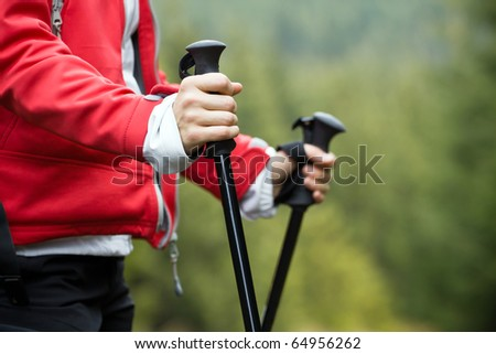 Nordic Walking in Autumn mountains, hiking woman - stock photo