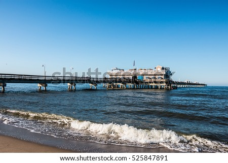 NORFOLK, VIRGINIA - MAY 2, 2015:  Ocean View Beach in springtime, with people on the fishing pier overlooking the Chesapeake Bay.