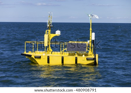 Normad type ocean weather research buoy has instruments that measure and record data like: sea surface and air temperature, air pressure, wave height, storm surge, wind speed and ocean oscillations