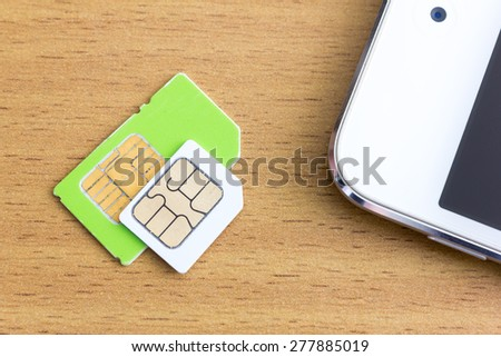 normal and micro sim card - stock photo