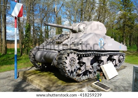 NORMANDY, FRANCE - MAY 5. This Sherman tank is situated beside the road in Normandy to commemorate the allied landings in Normandy in 1944 in Normandy, France on May 5th, 2016. - stock photo
