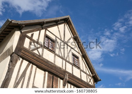 Normandy style timber frame building in La Roche Guyon, France - stock photo
