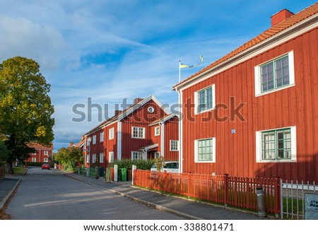 NORRKOPING, SWEDEN - OCTOBER 15: Red city during autumn on October 15, 2010 in Norrkoping. This is a residential area with old red wooden houses in the historic industrial town of Norrkoping.