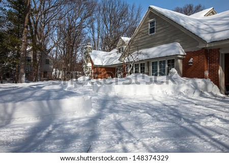 North America Residential House Yard Covered with Deep Snow in Winter - stock photo