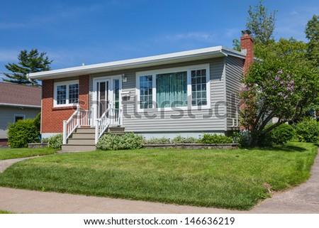 North America sixties era wooden bungalow  in suburbia. - stock photo