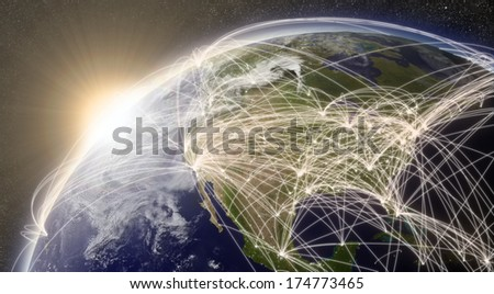 North America with network representing major air traffic routes. Elements of this image furnished by NASA. - stock photo