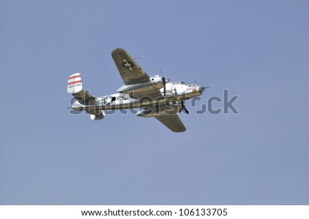 North American B-25 in flight during World War II reenactment at Mid-Atlantic Air Museum World War II Weekend and Reenactment in Reading, PA held June 18, 2008 - stock photo