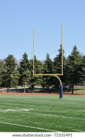 North American Football posts on field on sunny day - stock photo